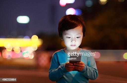 Boy Using Smart Phone : Stock Photo