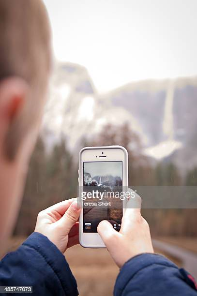 Boy Using SmartPhone to Take Photo at Yosemite