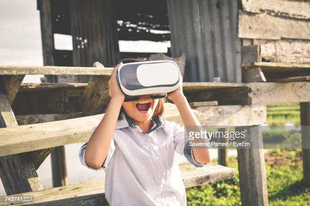 Boy Using Virtual Reality Simulator