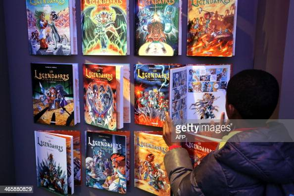 A boy visits the exhibition 'Les Legendaires' one of the most popular series of French comic strip on the first day of the 'Festival international de...