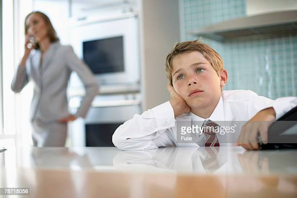Boy Waiting for Mother