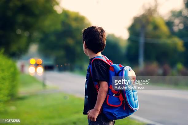 Boy waiting for school bus