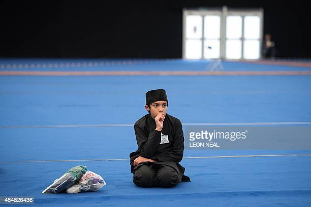 A boy waits to hear a speech by the fifth Caliph of the Ahmadiyya faith Mirza Masroor Ahmad during an annual threeday event known as the Jalsa Salana...