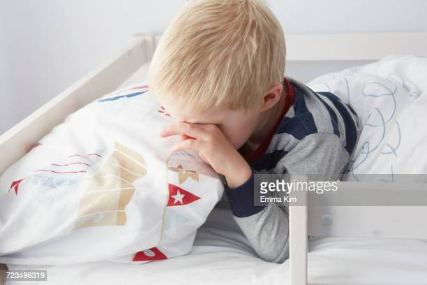 Boy waking up in bed