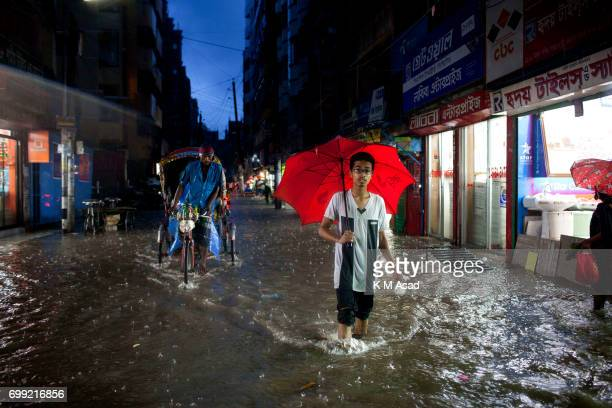 OLD DHAKA DHAKA BANGLADESH A boy walk in the rain water when heavy rainfall made waterlogging in Dhaka city The death toll rises to 150 in several...