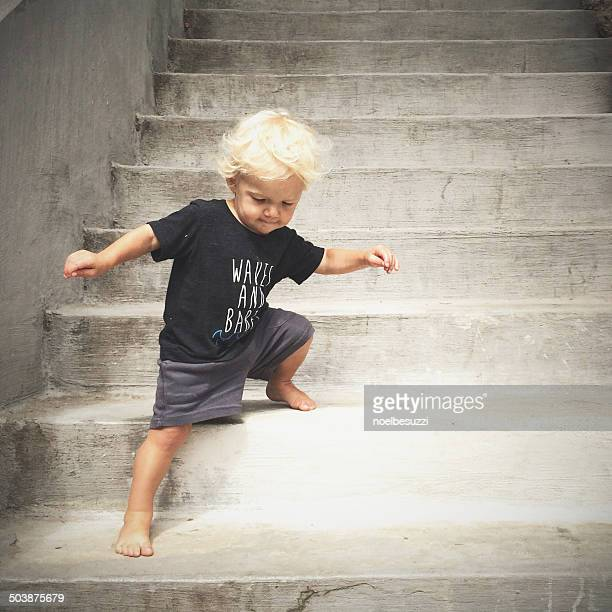 boy walking down steps