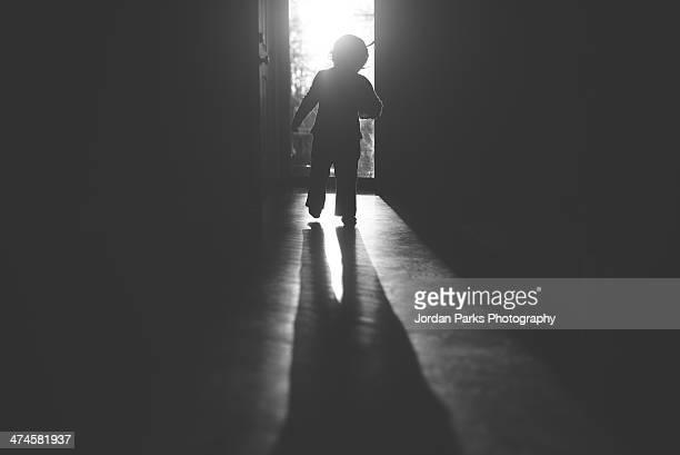 boy walking in light
