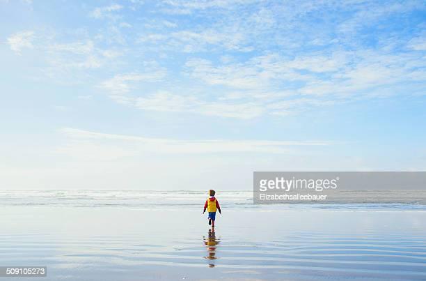Boy ( 4-5 ) walking on beach