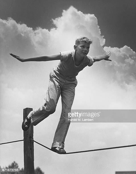 Boy Walking On Tightrope