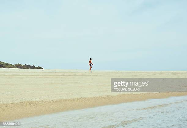 Boy walking the beach