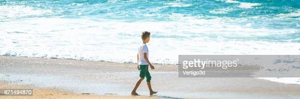 Boy walking to Sea