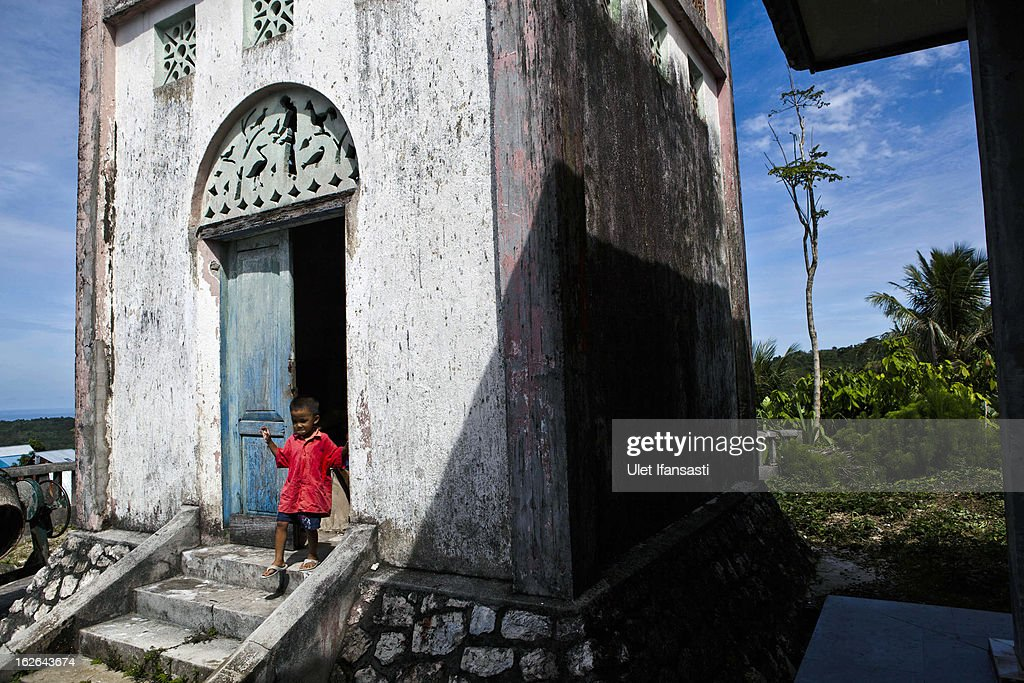 A boy walks as playing in church tower in Bawomataluwo village on February 22, 2013 in Nias Island, Indonesia. Some of historians and archaeologists estimated this is one of remaining Megalithic cultures in existence today. Stone Jumping is a traditional ritual, with locals leaping over large stone towers, which in the past resulted in serious injury and death. Stone jumping in Nias Island was originally a tradition born of the habit of inter tribal fighting on the island of Nias.