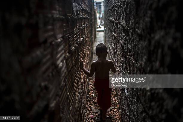 A boy walks between houses in a shantytown in Recife Brazil on Friday Jan 22 2016 Zika has spread from Brazil throughout Latin America prompting the...