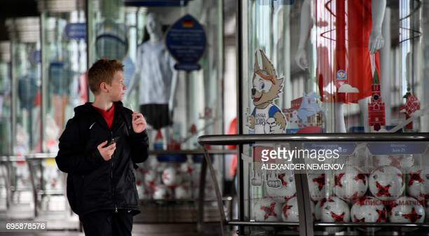 A boy walks by an exhibition devoted to the FIFA Confederations Cup football tournament and Football world Cup 2018 on a platform of a Vorobyovy Hill...