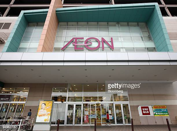 A boy walks in front of an Aeon Co shopping center in Toda City Saitama Prefecture Japan on Monday July 6 2009 Aeon Co is expected announce earnings...