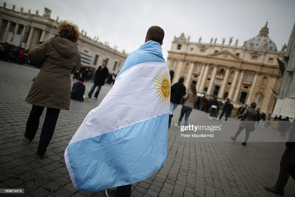 A boy walks in St Peter's Square wrapped in the flag of Argentina before Pope Francis gave his first Angelus blessing on March 17, 2013 in Vatican City, Vatican. The Vatican is preparing for the inauguration of Pope Francis on March 19, 2013 in St Peter's Square.