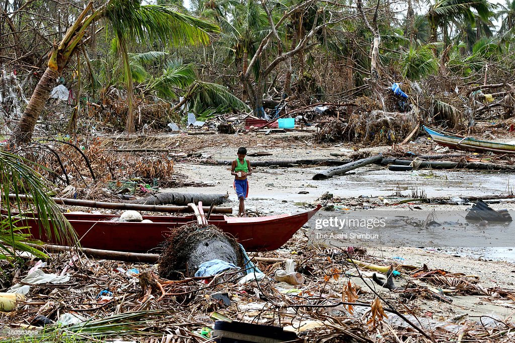 A boy walks on a debris scattered beach in Jinamoc Island on November 16, 2013 in Basey, Philippines. Typhoon Haiyan which ripped through Philippines over the weekend has been described as on of the most powerful typhoons ever to hit land, leaving thousands dead and hundreds of thousands homeless. Countries all over the world have pledged relief aid to help support those affected by the typhoon however damage to the airport and roads have made moving the aid into the most affected areas very difficult. With dead bodies left out in the open air and very limited food, water and shelter, health concerns are growing.
