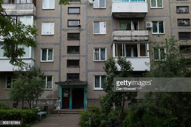 A boy walks out of Soviet style housing in a run down area of Vostok Minsk on July 03 2017 in Minsk Belarus The postSoviet republic of Belarus...