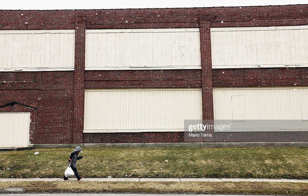 A boy walks past a boarded up factory on March 4, 2012 in Lima, Ohio. A census report released in 2011 showed that 15.3 percent of Ohioans live in poverty, the highest rate in the state in more than 30 years. Economic conditions are a major concern among voters in the state. The Republican Party continues the process of determining who will be their general election candidate against President Barack Obama in the fall with the upcoming Super Tuesday vote.