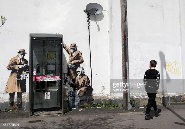 A boy walks past a piece of new graffiti street art claimed to be by the secretive underground guerilla artist Banksy which appeared on the side of a...