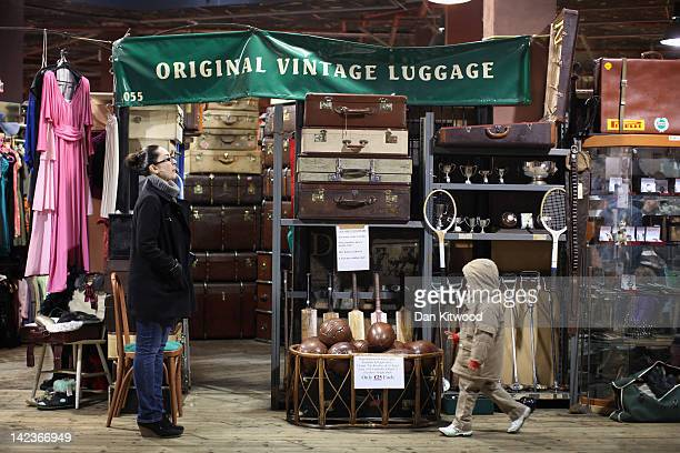 A boy walks past a stall selling vintage luggage in Camden Market on March 31 2012 in London England Camden in North London has been one of the...