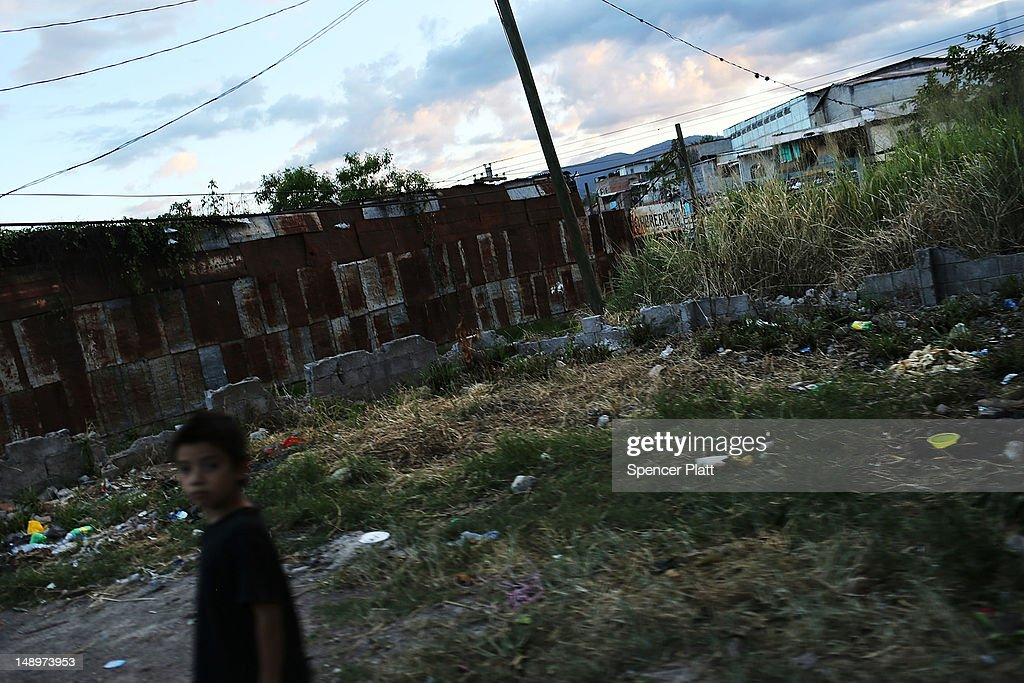 A boy walks through a neighborhood with heavy gang violence on July 20, 2012 in Tegucigalpa, Honduras. Honduras now has the highest per capita murder rate in the world and its capital city, Tegucigalpa, is plagued by violence, poverty, homelessness and sexual assaults. With an estimated 80% of the cocaine entering the United States now being trans-shipped through Honduras, the violence on the streets is a spillover from the ramped rise in narco-trafficking.
