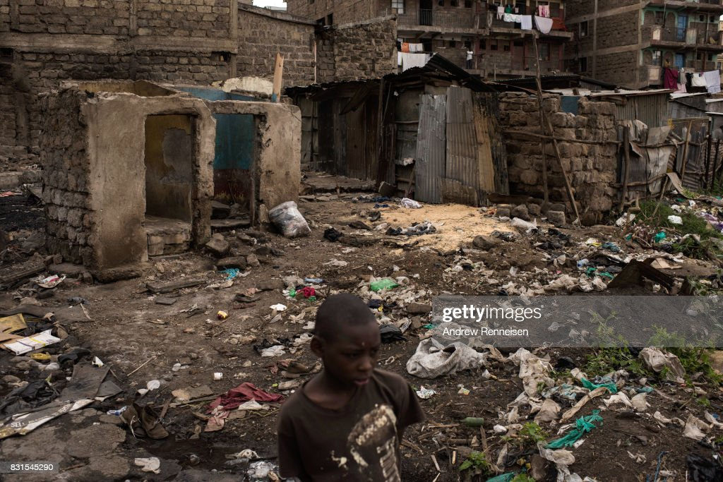 A boy walks through homes that were burned in unrest two days prior in the Mathare North neighborhood on August 14, 2017 in Nairobi, Kenya. Nairobi remained peaceful, but tensions remain high as oppositions supporters wait to hear from candidate Raila Odinga who has rejected the results that named Uhuru Kenyatta to his second term in Kenya's 2017 presidential election.