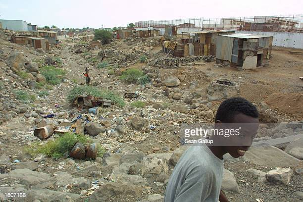 A boy walks through the BaalBalla slum February 21 2003 in the outskirts of Djibouti Town Djibouti BaalBalla is one of many Djibouti slums swollen by...