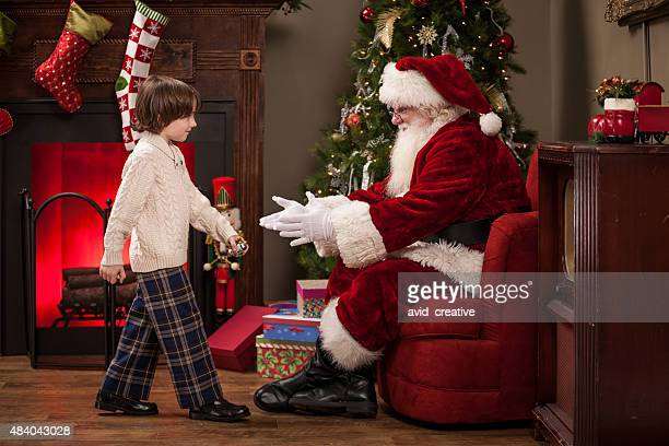 Boy Walks to Real Santa Sitting in Living Room