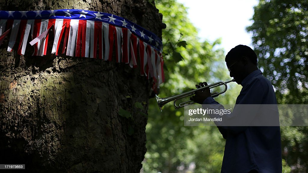A boy warms up on the trumpet on June 30, 2013 in London, England. American Democrats living in London gather in Portman Square for the largest Independence Day celebration in London ahead of the American federal holiday on the 4th July which commemorates the Declaration of Independence on July 4, 1776 which declared them the USA free from the Kingdom of Great Britain.