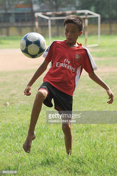 A boy warms up prior to a recruitment held by HAGLArsenal JMG Academy to choose future talented footballers for the central Vietnambased academy at a...