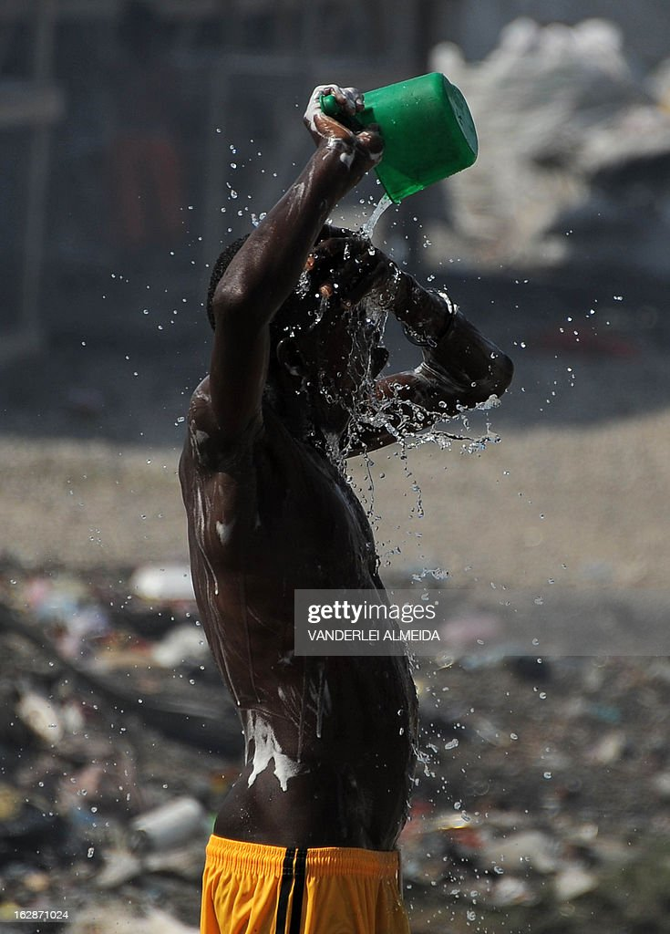 A boy washes himself at a camp of survivors of the January 2010 quake in Haiti which killed 250,000 people, on February 28, 2013 in Port-au-Prince. The UN has in Haiti a huge mission of peacekeepers led by Brazil, helping the impoverished country with its political strife and the impact the devastating 2010 quake. Hundreds of thousands are still living rough in squalid makeshift camps, and they now face rampant crime, a cholera outbreak and the occasional hurricane. AFP PHOTO/VANDERLEI ALMEIDA