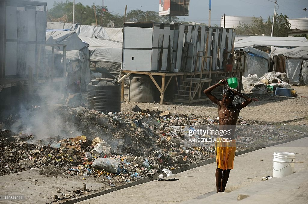 A boy washes himself at a camp of survivors of the January 2010 quake in Haiti which killed 250,000 people, on February 28, 2013 in Port-au-Prince. The UN has in Haiti a huge mission of peacekeepers led by Brazil, helping the impoverished country with its political strife and the impact the devastating 2010 quake. Hundreds of thousands are still living rough in squalid makeshift camps, and they now face rampant crime, a cholera outbreak and the occasional hurricane.