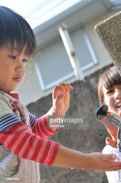 Boy Washing Hands at Park