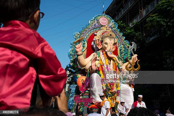 A boy watches the Idol of lord Ganesha when it is taken for immersion There is a lot of fervour surrounding Ganapati festival Ganesha Chaturthi or...