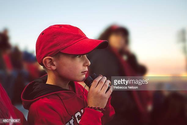 boy watching football game