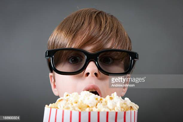Boy Watching Movie with Popcorn