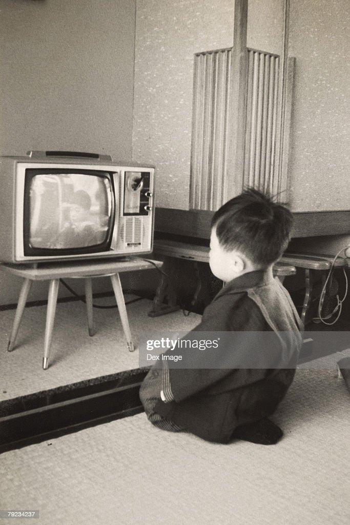 Boy watching television program : Stock Photo