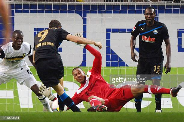 Boy Waterman of Aachen saves a kick by Nick Proschwitz of Paderborn during the Second Bundesliga match between SC Paderborn and Alemannia Aachen at...