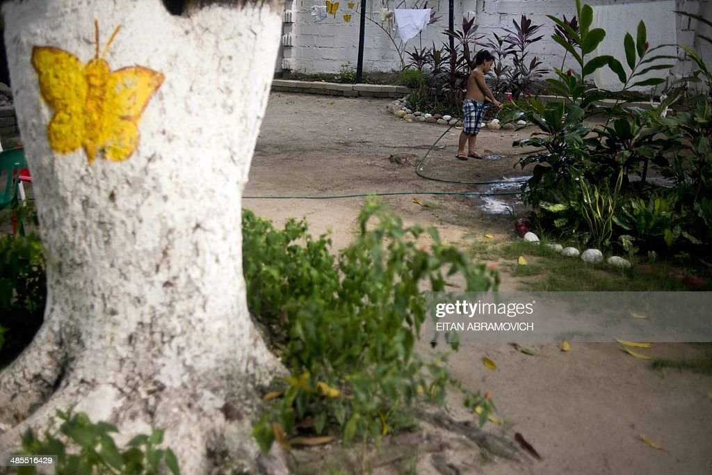 A boy waters plants in the yard of a restaurant in the Colombian village of Aracataca, hometown of late Colombian Nobel Prize 1982 in Literature laureate Gabriel Garcia Marquez, on April 18, 2014. Garcia Marquez, the author of 'One Hundred Years of Solitude', died on Thursday at home in Mexico City with his wife and two children at his side.