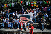 A boy waves a flag bearing a picture of a Kurdish Workers Party's jailed leader Abdullah Ocalan during a rally gathering ProKurdish supporters...