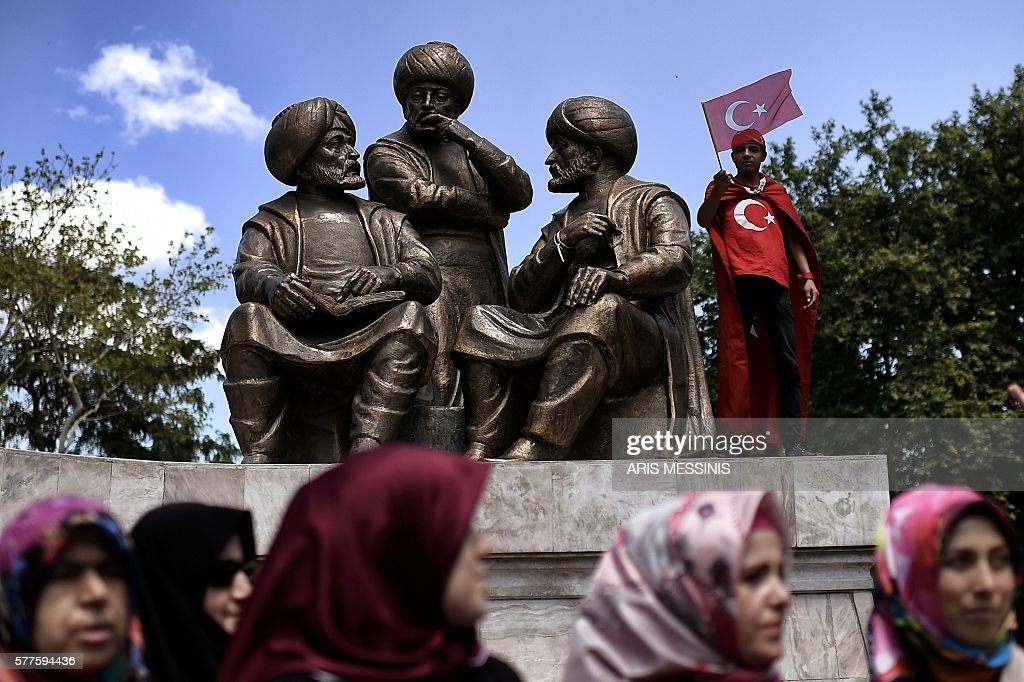 TOPSHOT - A boy waves a Turkish flag near Sultan Mehmed II statue during a demonstration in support to the Turkish President at the Sarachane park in Istanbul on July 19, 2016. The Turkish army said on July 19 that the vast majority of its members had no links with the July 15 attempted coup and warned that the putschists would face severe punishment. The armed forces blamed the 'Fethullah Terrorist Organisation' (FETO) for the failed putsch, referring to Fethullah Gulen, a one-time ally turned foe of President Recep Tayyip Erdogan. Turkey's prime minister said on July 19 his government had sent four files to the United States, as Ankara seeks the extradition of US-based preacher Fethullah Gulen. / AFP / ARIS