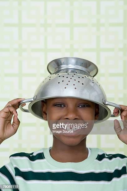Boy wearing a colander