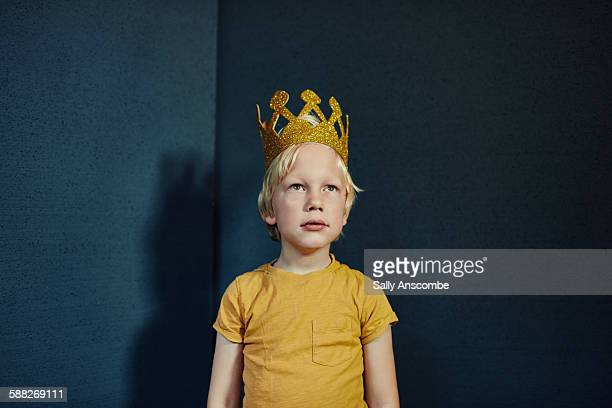 Boy wearing a gold crown