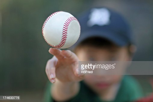 Boy wearing a hat throwing a baseball