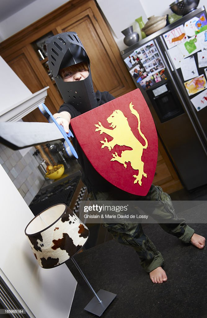 Boy wearing a knight costume with a sword : Stock Photo