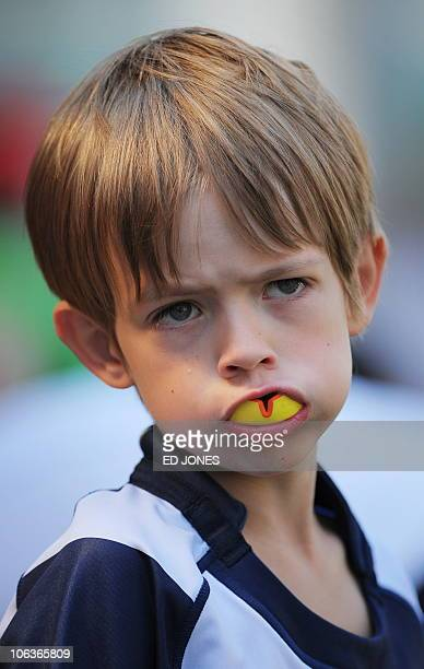 A boy wearing a mouthguard attends a Guiness World Record attempt to stage the world's largest 'mini rugby tournament' in Hong Kong on October 30...