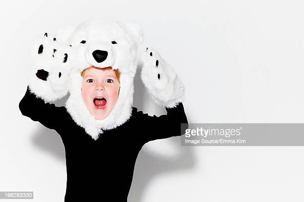 Boy wearing bear head and claws