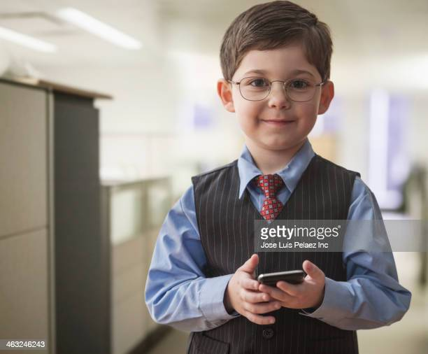 Boy wearing businessman outfit in office