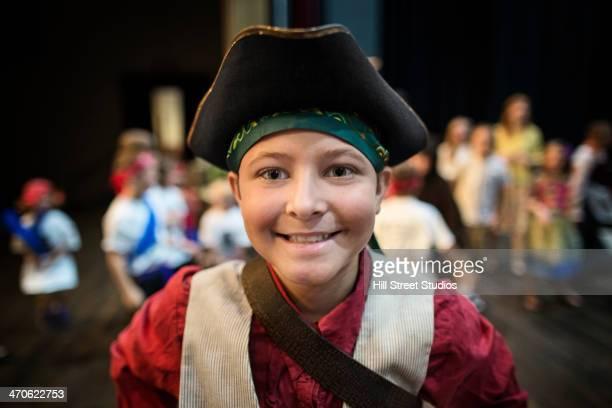 Boy wearing costume in play